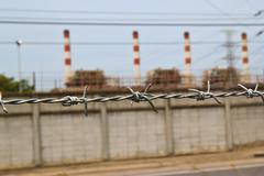 barb wire fence at chonburi - stock photo