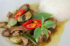 Stir-fried  green curry with pork Stock Photos