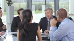 Happy and attractive professional team are brainstorming in a business meeting - stock footage