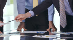 Happy and attractive professional team are brainstorming in a business meeting Stock Footage