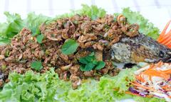 crispy snake-head fish fried  with spicy salad - stock photo