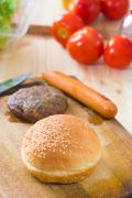making hamburger fast food ingredients with plenty of raw materials on the ba - stock photo