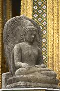 the stone buddha image in the emerald buddha temple of thailand - stock photo
