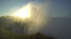 Sun and mist from victoria falls - stock footage