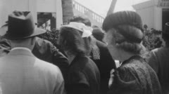 Horse race people. (Vintage 1940's 16mm film footage). Stock Footage