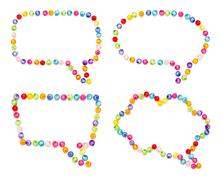 Speech bubble decorate by colorful beads on white background Stock Photos