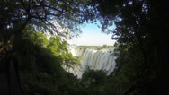 Stock Video Footage of Victoria Falls through a window of trees