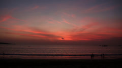 Timelapse people after sunset at the beach Stock Footage