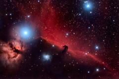 horsehead nebula and flaming tree  in the constellation orion - stock photo