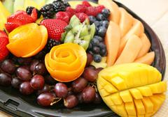 Variety of fresh fruit on a plate - stock photo
