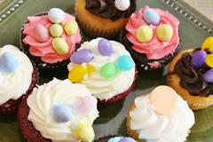 Cupcakes with oval eggs Stock Photos