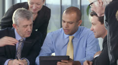 Happy successful business team watching the world markets Stock Footage