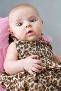 baby girl in leopard print dress - stock photo
