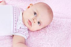 Newborn on pink blanket Stock Photos