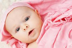 baby girl in pink scarf - stock photo