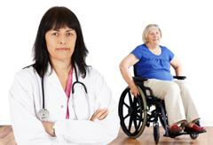 woman doctor and handicap senior - stock photo