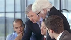 Happy dynamic business team brainstorming in a meeting Stock Footage