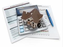 mortgage application form with a calculator and house. - stock illustration