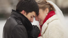 Newlyweds heat each other - stock footage