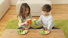 Kids having their healthy meal at home. - stock footage