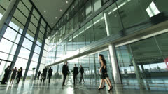 Time lapse of large business group in a light and modern office building Stock Footage