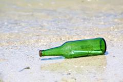 Bottle with message on the beach Stock Photos
