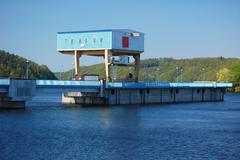 Hydro power plant at the dam - stock photo