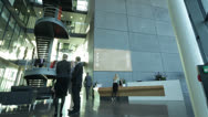 Stock Video Footage of Time lapse of large business group in a light and modern office building
