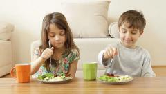 Kids having their healthy meal at home. Stock Footage