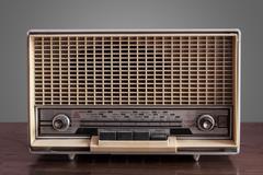 Vintage radio on grey background Stock Photos