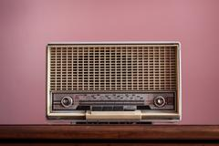 vintage radio on pink background - stock photo
