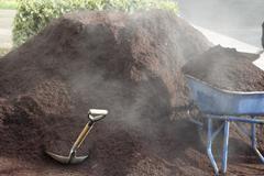 Steaming bark dust Stock Photos