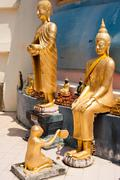 Monkey offers honey comb to buddha and buddha with begging bowl. thailand Stock Photos
