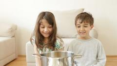 Kids making popcorn by themselves. Stock Footage