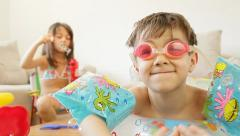 Kids fantasize that they are on a beach. Stock Footage
