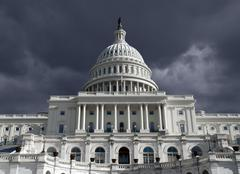 capitol dome with dark storm sky - stock photo