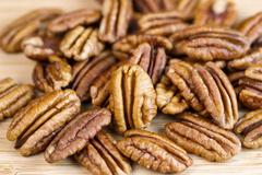 freshly roasted pecan nuts - stock photo
