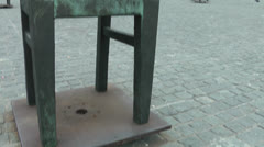 Empty chair Jewish community memorial in Krakow, Poland Stock Footage