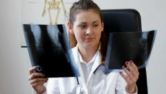 Young specialist compare two x-ray images Stock Footage
