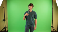 A man with mustache mask and he is acting like a girl Stock Footage