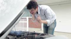 Man getting very upset at broken car Stock Footage