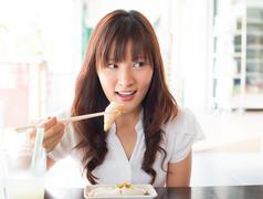 Asian girl eating dim sum Stock Photos