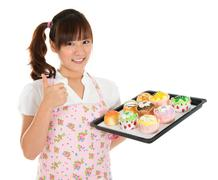 thumb up asian female baking - stock photo