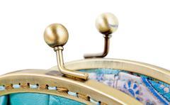 Open brass clutches of retro stile handbag Stock Photos