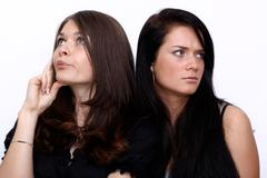 Couple women - brown hair against the brunette Stock Photos