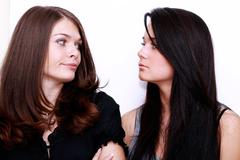 couple women - brown hair against the brunette - stock photo