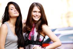 couple women - brown hair against the brunette - stock photo