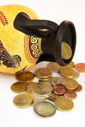 amphora with coins - stock photo
