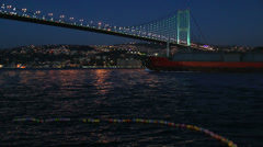 Container ship passing under the Bosporus Bridge Stock Footage