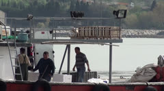 Reloading fish from boat on truck 4 Stock Footage